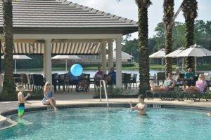 Families enjoying the pools at Plantation Bay