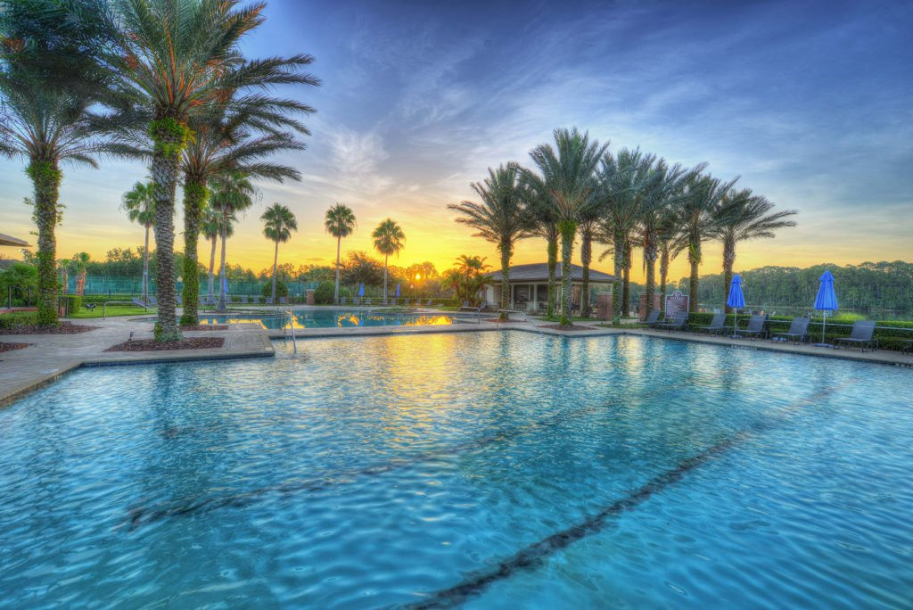 The two pools at Plantation Bay during a beautiful sunset